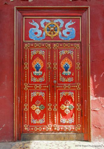 blue khata at the top of door Gandan Khiid in Mongolia