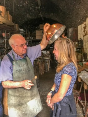 demonstrating the vibration from a proper copper pot