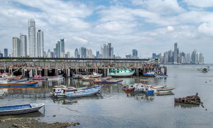 fishing harbor with panama city skyline