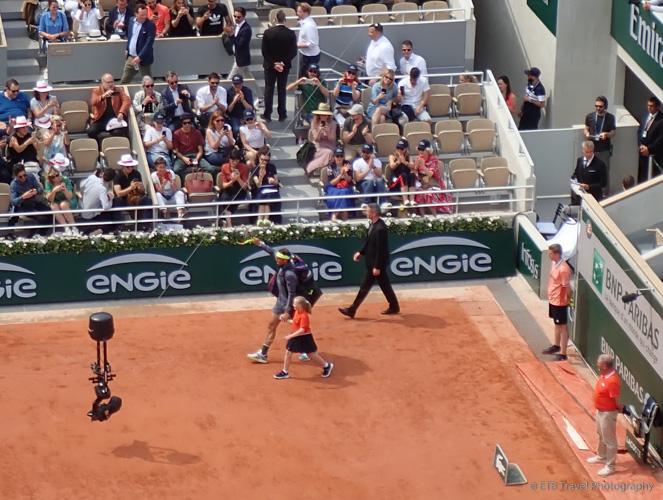 Nadal walking on court at Roland-Garros