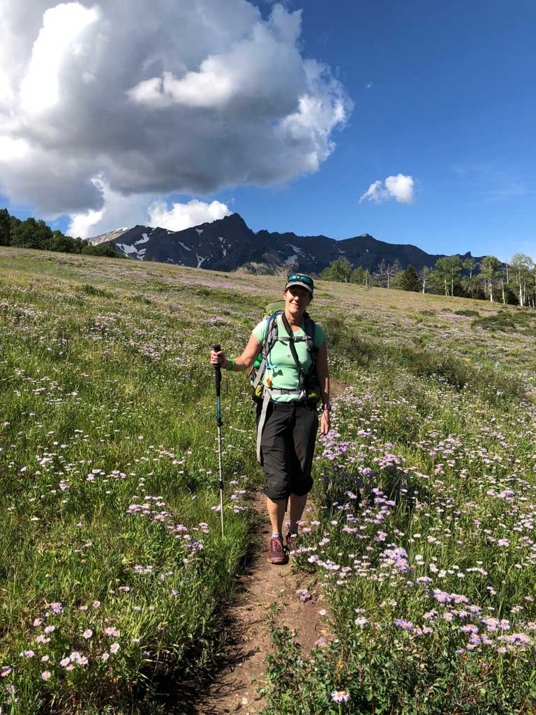 me in a field of aspen daisy on the sneffels traverse