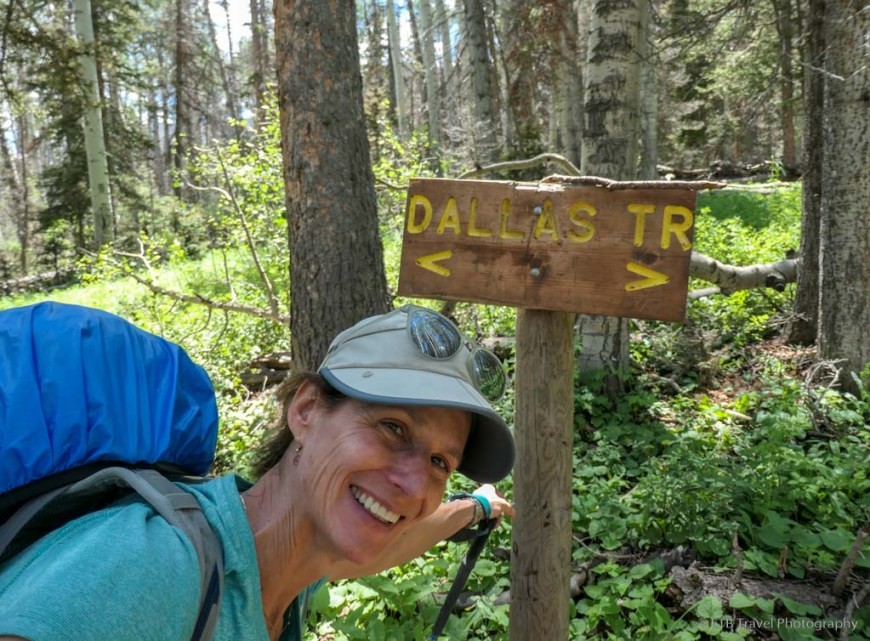 Tina and the Dallas Trail sign on the Sneffels Traverse