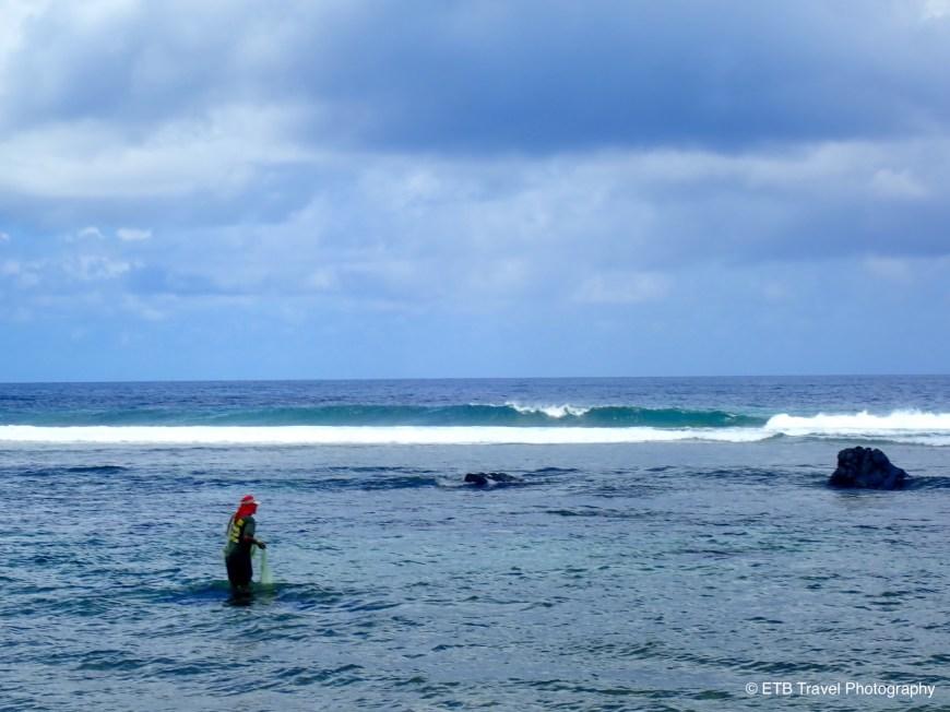Fisherman at the beach on American samoa