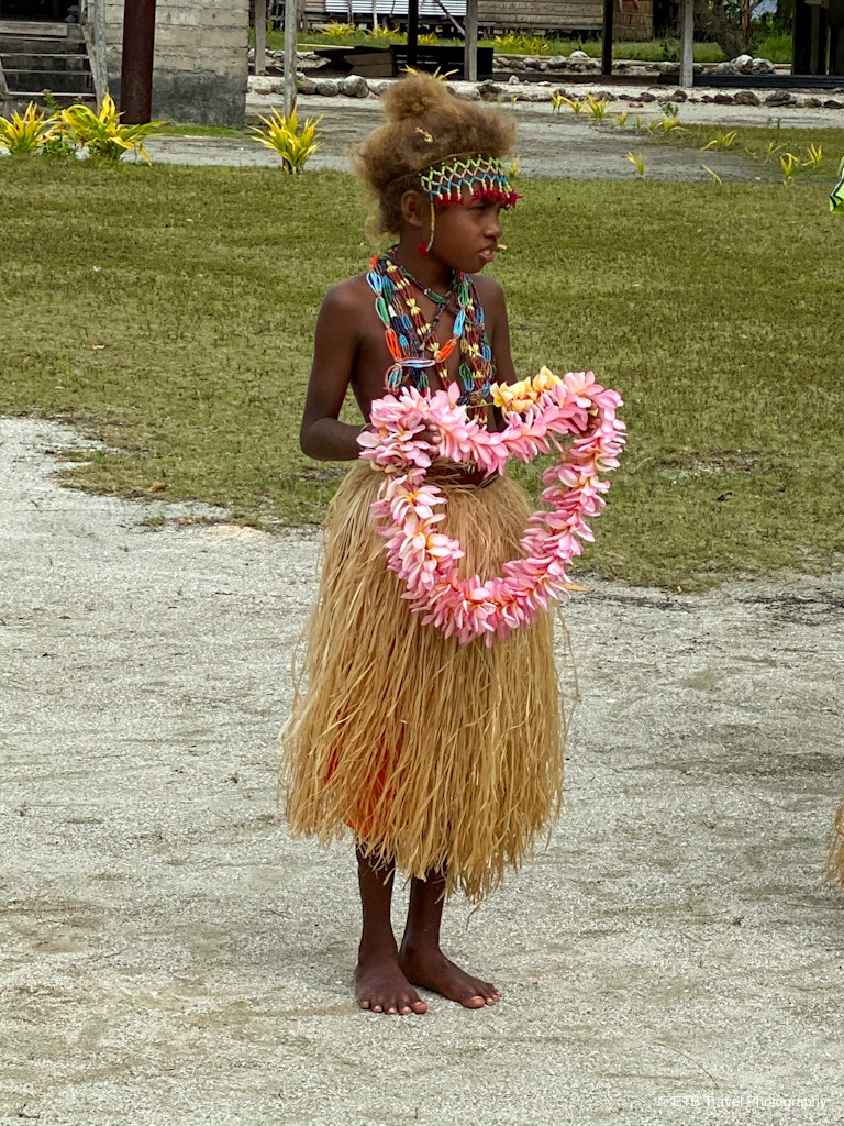 island presenting a lei in the Solomons
