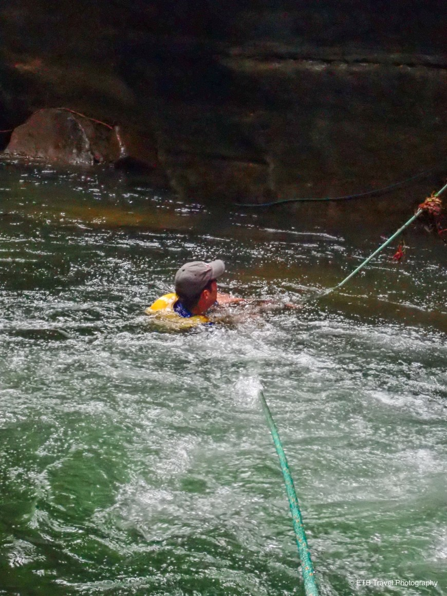 Crossing the river at the base of a rapid