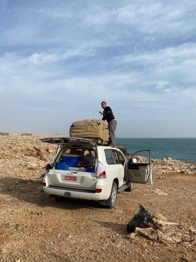 unpacking at Fins Beach near Wadi Shab in Oman