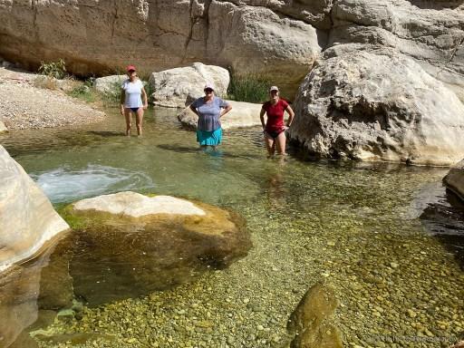 wading in Wadi Bani Khalid