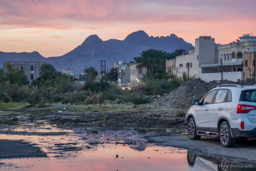 sunrise and off roading out of the parking lot at the goat market in nizwa
