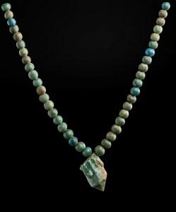 String of beads with a glazed quartz pendant 1700–1550 B.C. Faience, glazed quartz *Harvard University—Boston Museum of Fine Arts Expedition *Photograph © Museum of Fine Arts, Boston