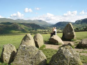 Sitting on a stone at the Castlerigg circle, in England's Lake District, inspires contemplation. (photo: Rick Steves)