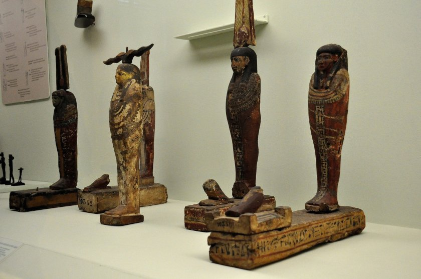 These are wooden statues of Patah-Seker. Patah was the protector god of artisans while Osiris was the god of the underworld. Seker (bird) was the god of the cemetery. When a person dies, a piece from his body is taken, embalmed and placed in a box, and then sealed with a wax. Thereafter, a Seker bird is put on the top. Ancient Egyptians, believed that the deceased person becomes immortal by doing these steps.