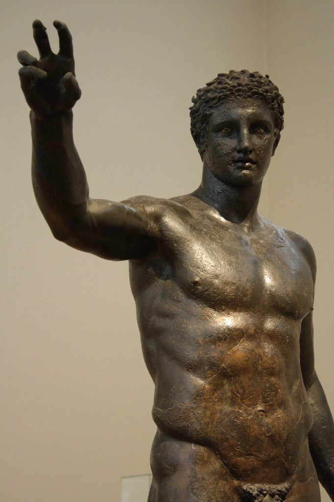 The bronze Antikythera Youth c. 340 BCE.