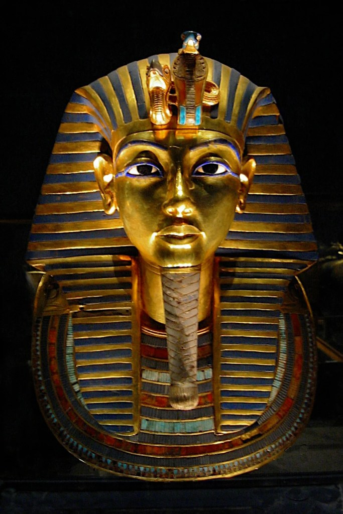 The death mask of Egyptian pharaoh Tutankhamun. The mask is made of gold, precious stones and glass inlay, 14th century BCE. (Museum of Egyptian Antiquities, Cairo)