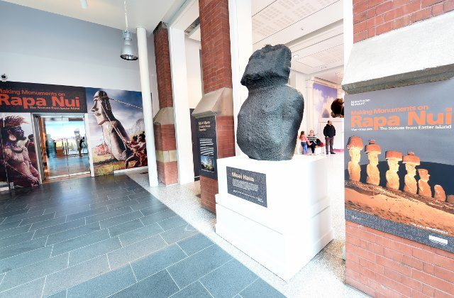 """Entrance to Making Monuments on Rapa Nui at Manchester Museum in Manchester, UK. """"Moai Hava"""" is displayed on the right. Photo: Joe Gardner. (Courtesy of Manchester Museum.)"""