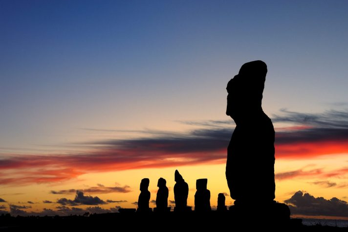 Moai against a setting sun on Easter Island, Chile. Adam Stanford @Aerial-Cam for RNLOC. (Courtesy of Manchester Museum.)