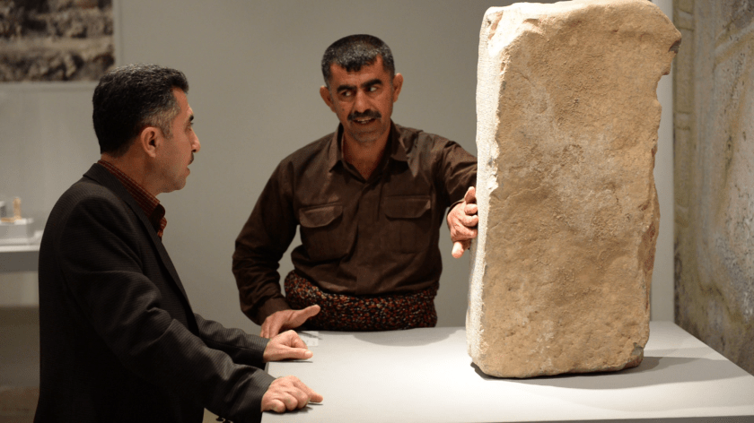 Interviewing Mr. Nejem-Alddin Ahmad (who stands between the stela and Mr. Hashim Hama Abdullah, the director of the Sulaymaniyah Museum. A snapshot using VLC media player; video interview using my Nikon D610.
