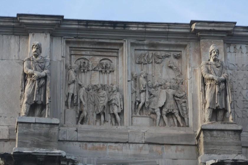 Between two Dacian prisoners taken from an earlier monument to Trajan, are two sculpted 3x2 m panels (of 8 in total) which were taken from a now lost monument in honour of Marcus Aurelius (c. 176 BCE).