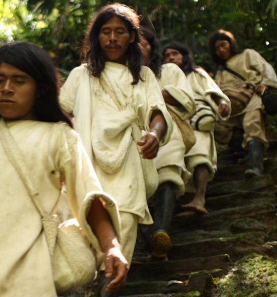 Kogi -- an indigenous ethnic group that lives in the Sierra Nevada de Santa Marta in Colombia -- walking down the stairs in a special ceremony at Ciudad Perdida in Colombia. (Courtesy of GHF.)