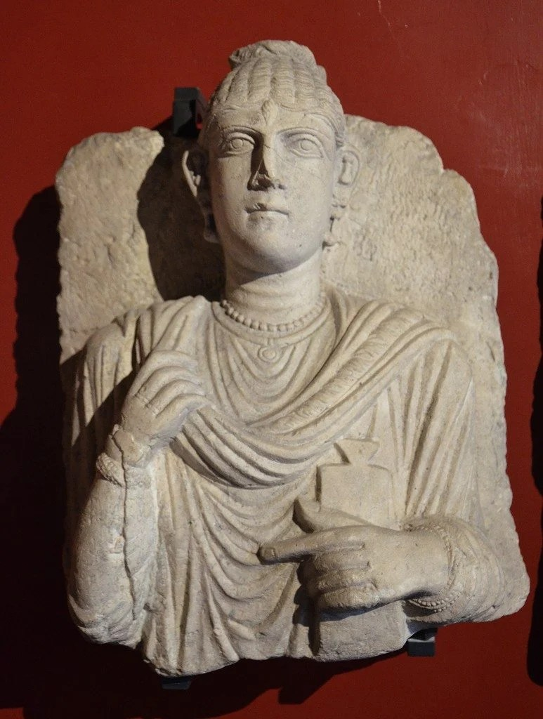 Funerary bust of a woman from Palmyra, she is holding a writing tablet on her left hand Roman Imperial period, 3rd century AD Vatican Museums, Rome