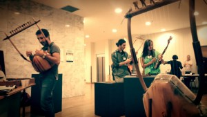 People playing instruments made by Luthieros music instruments.