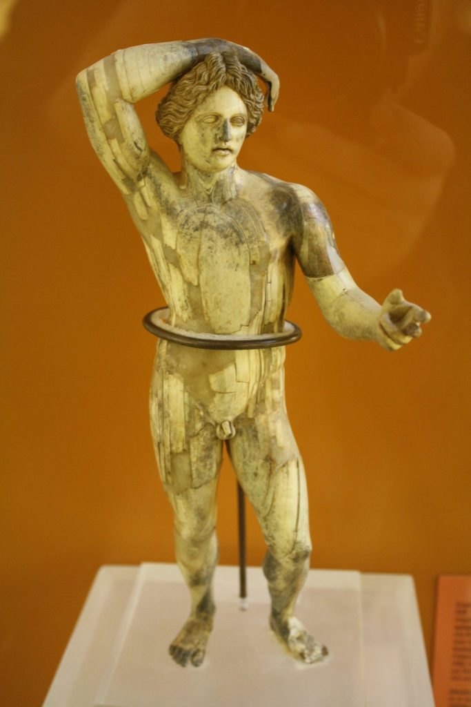 An ivory statuette of Apollo Lykeios, 3rd Century BCE. The statuette was restored after being found in 200 pieces at the bottom of a well. (Agora Museum, Athens)