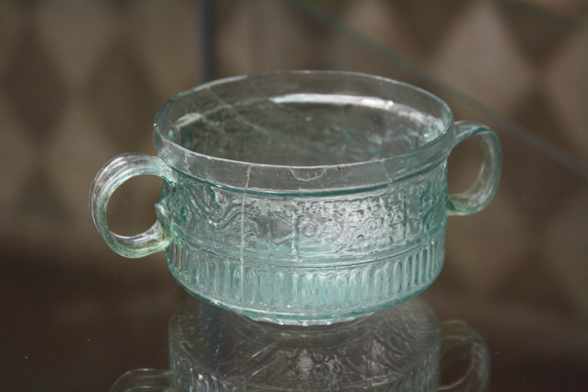 A two-handled cup. Roman glassware at the Archaeological Museum of Pavia. Image © Mark Cartwright.