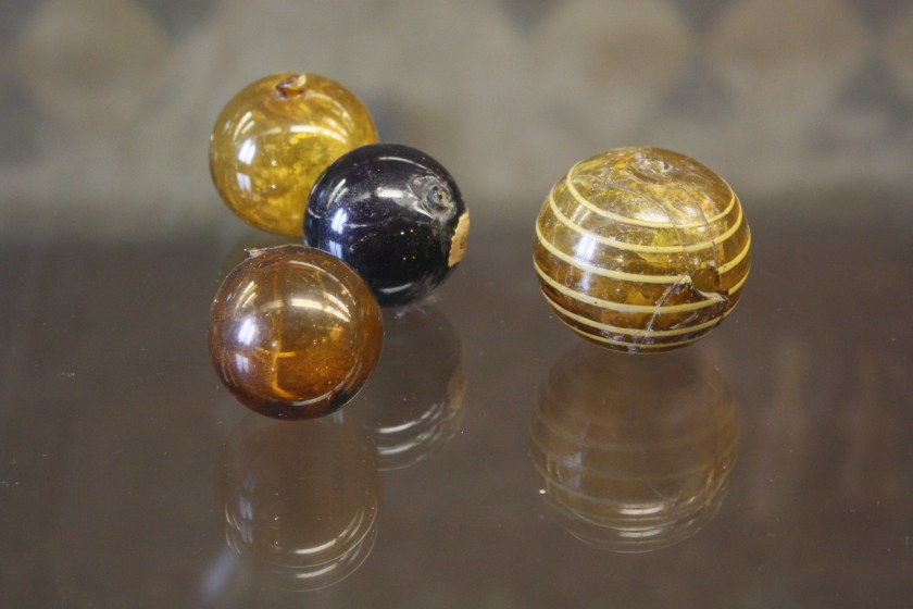 Glass perfume spheres. Roman glass at the Archaeological Museum of Pavia. Image © Mark Cartwright.