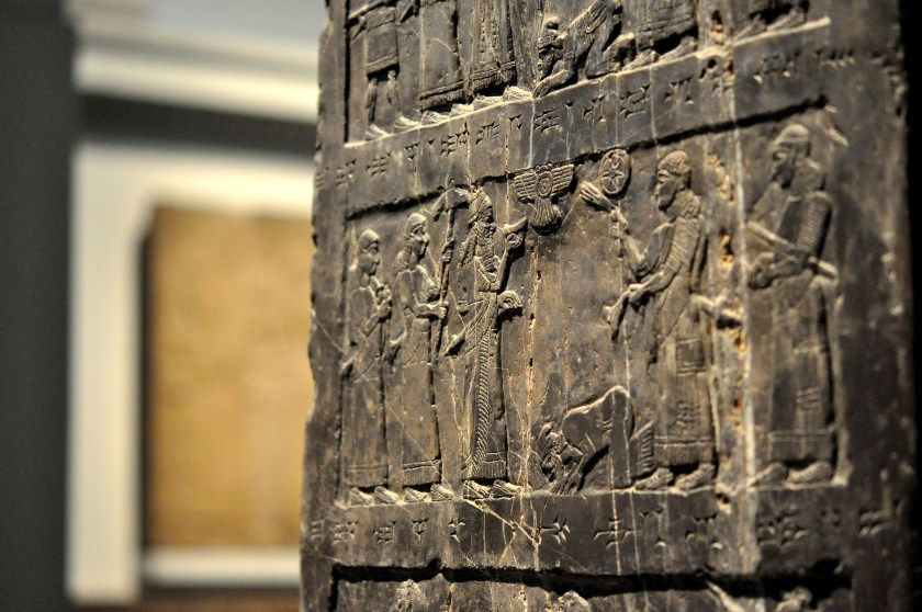 Jehu (son of Omri), king of Israel, bows and prostrates before Shalmaneser III. The Assyrian king is accompanied by 4 attendants. Jehu is thought to be a Biblical figure. Detail of the Black Obelisk, Side A, register 2. Photo © Osama S. M. Amin. Black Obelisk of Shalmaneser III.