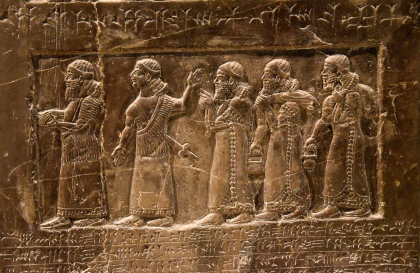 Side B: There are 2 Assyrian officials introducing 3 tribute-bearers from the land of Patina. Photo © Osama S. M. Amin. Black Obelisk of Shalmaneser III.