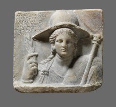 Relief Stele Depicting Isis as Demeter with Dedicatory Inscription. Second half of 3rd–early 2nd century BC. Marble. H. 12.2 in; W. 13.4 in; D. 3.1 in (H. 31 cm; W. 34 cm; D. 8 cm). From Dion. Sanctuary of Isis, Courtyard of the temple of Isis Lochia. Archaeological Museum of Dion. Photo © Hellenic Ministry of Culture and Sports, Ephorate of Antiquities of Pieria, and the Dion Excavations. Courtesy Onassis Cultural Center NY.