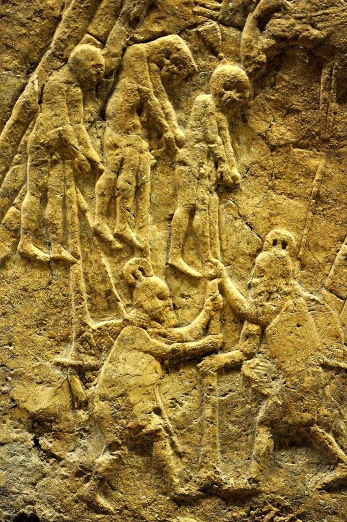 Early in the battle, some of the soldiers of Lachish were captured by the Assyrian army. This detail of the stone panel depicts an impalement process; three prisoners of war are being impaled by Assyrian soldiers. Impalement is not an ordinary method of execution; it is a very brutal and ruthless way that was used in wartime to suppress rebellions. Those prisoners of war were impaled in front of the city of Lachish to terrorize them. The death is very painful is typically slow; many hours are needed to kill the victim. From Nineveh (modern-day Mosul Governorate, Iraq), Room XXXVI of the South-West Palace, panels 7. The British Museum, London. Photo © Osama S. M. Amin.