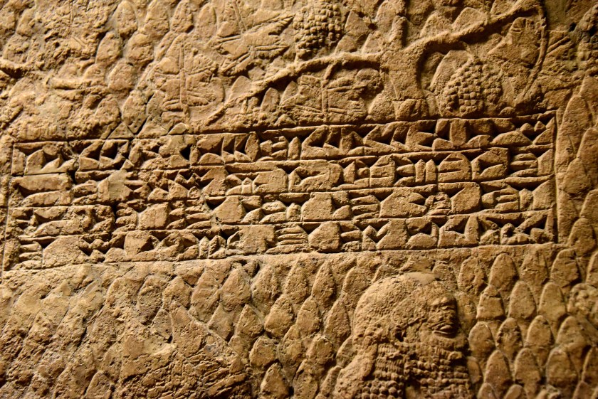 "This is one of 2 cuneiform inscriptions which were carved on one of the reliefs. These 4 horizintal lines read ""Sennacherib, the mighty king, king of the country of Assyria, sitting on the throne of judgment, before (or at the entrance of) the city of Lachish (Lakhisha). I give permission for its slaughter"". From Nineveh (modern-day Mosul Governorate, Iraq), Room XXXVI of the South-West Palace, panels 11-13. The British Museum, London. Photo © Osama S. M. Amin."