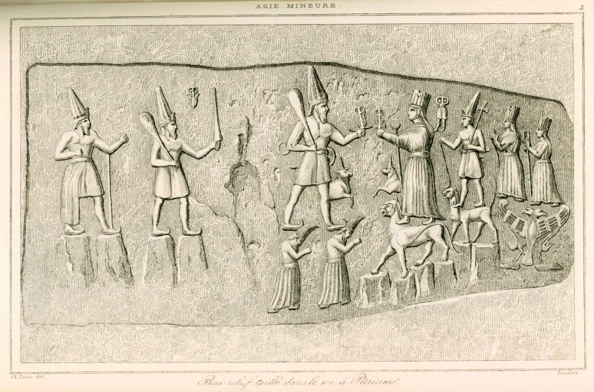 Engraving from a relief at Yazilikaya by French archaeologist Charles Texier (1882). Teshub stands on two deified mountains (depicted as men) alongside his wife Hepatu, who is standing on the back of a panther. Behind her, their son, their daughter and grandchild are respectively carried by a smaller panther and a double-headed eagle. Hittite