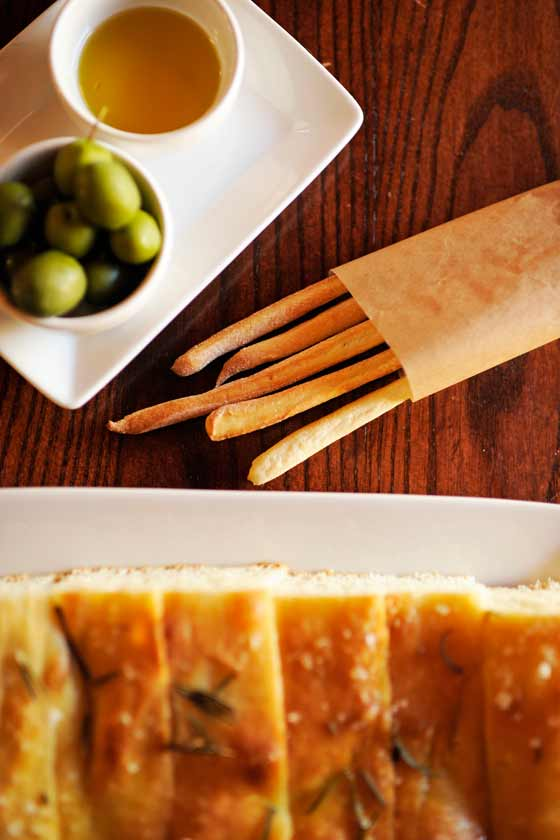 Foccacia, olives, olive oil and breadsticks
