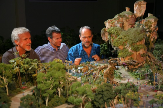 © Copyright Disney |  WDI's Joe Rohde (right) shares highlights of the project model with Cameron (left) and Walt Disney Parks & Resort Chairman Tom Staggs. Scheduled to open in 2017, the AVATAR-inspired land will be part of the largest expansion in Disney's Animal Kingdom history.