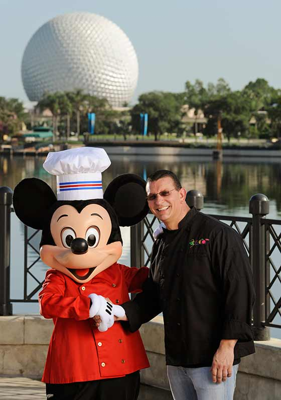 "Chef Robert Irvine from Food Network's ""Dinner Impossible"" gets tips from Chef Mickey for his appearance at the Epcot International Food & Wine Festival at Walt Disney World Resort. Irvine will host the premium event ""Food for Thought"" Sept. 26, 1914, from 10 a.m.-noon; he'll also host a culinary demonstration at the Festival Center at 1 p.m. Sept. 27"