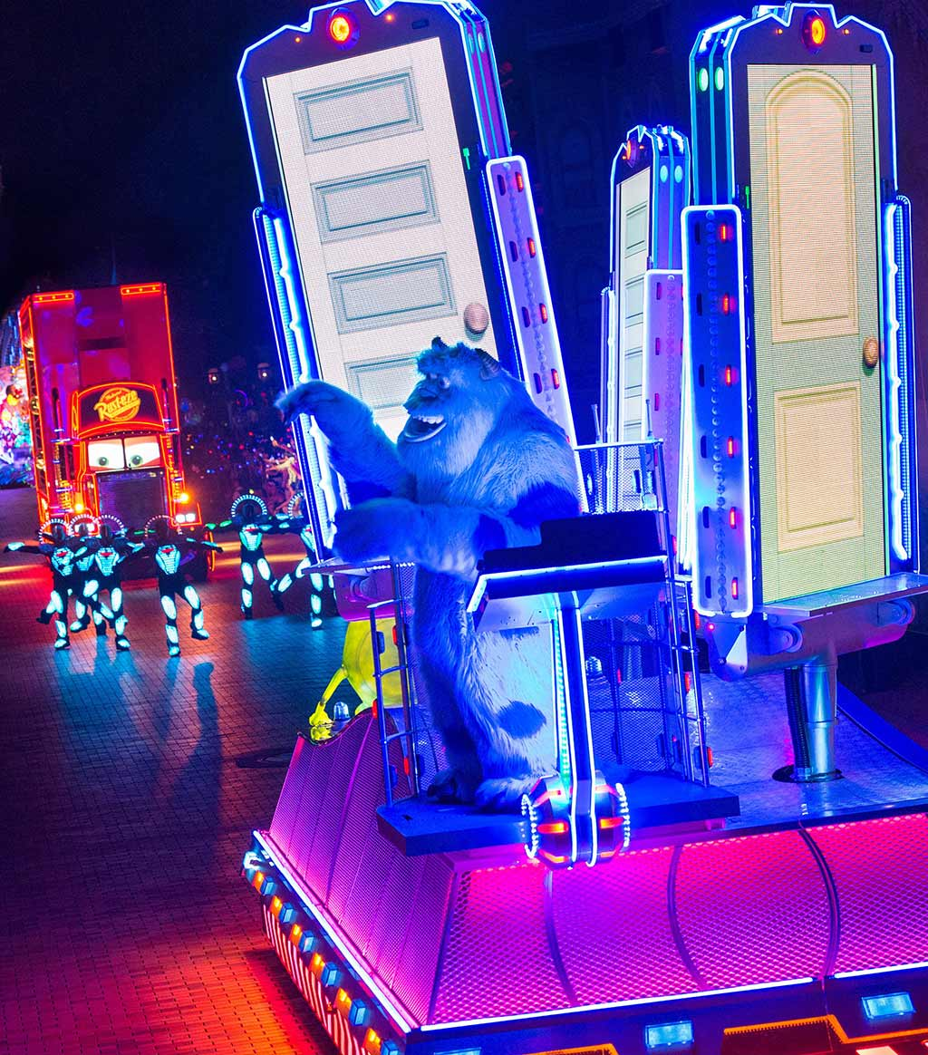 Sulley waves from a parade float