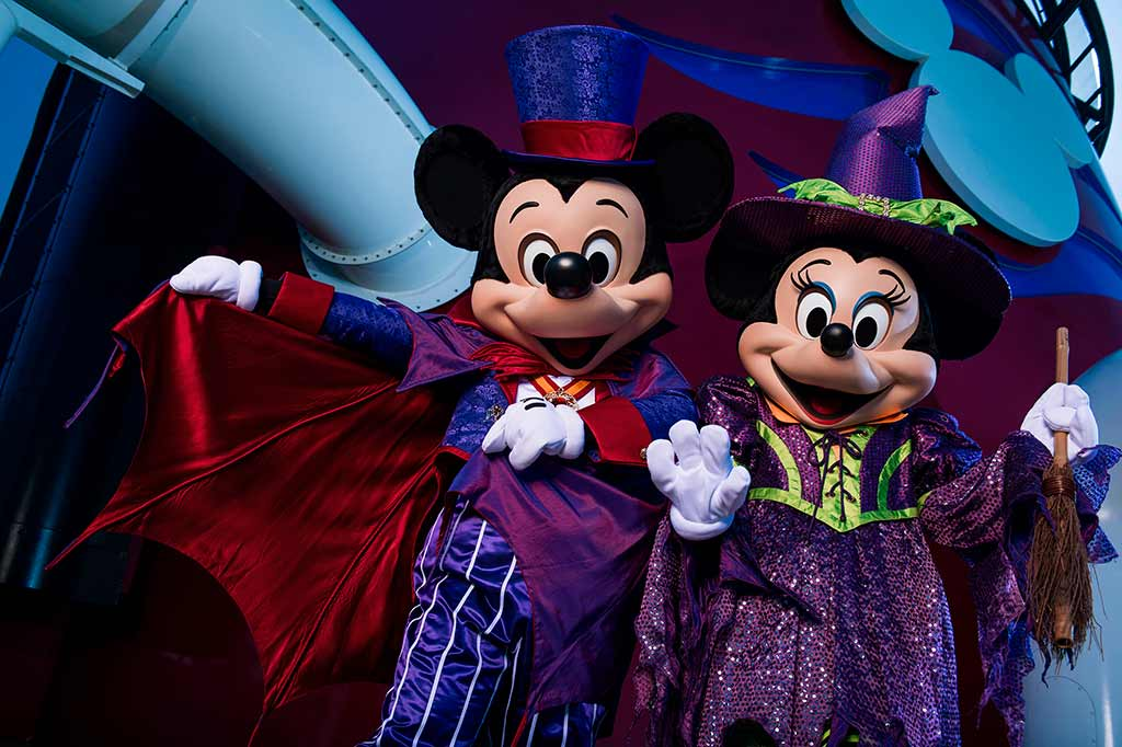 Mickey and Minnie Mouse in Halloween Costumes