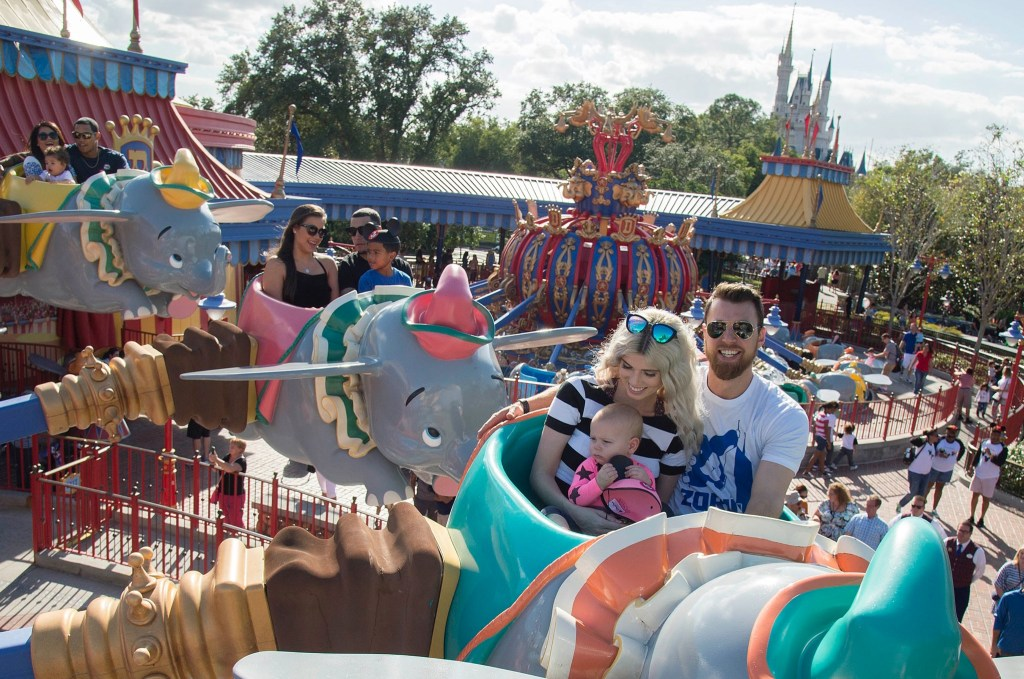 World champions (front to back) MVP Ben Zobrist, Javier Baez and Addison Russell, of the Chicago Cubs, take flight with their families aboard Dumbo the Flying Elephant, Saturday, Nov. 5, 2016, at Magic Kingdom Park in Lake Buena Vista, Fla. The players were later honored among thousands of fans in a parade at Walt Disney World celebrating the team's historic victory. (Preston Mack, photographer)