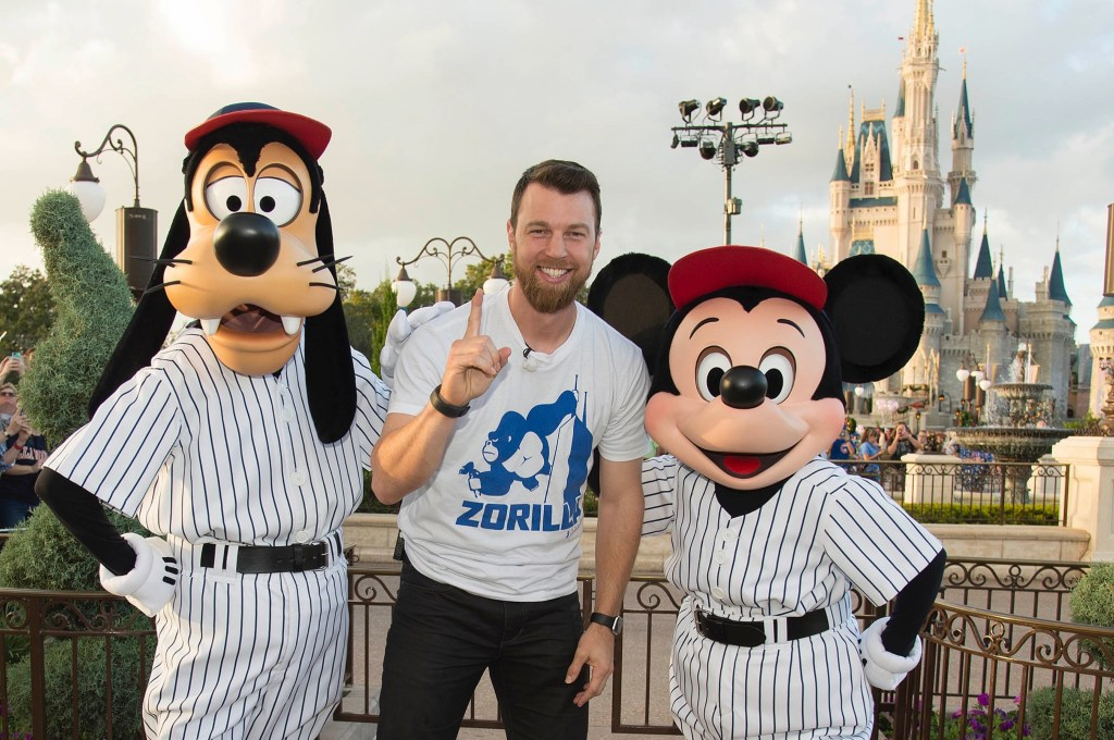 World championship MVP Ben Zobrist, of the Chicago Cubs, poses for a victory photo with Goofy and Mickey Mouse Saturday, Nov. 5, 2016, at Magic Kingdom Park in Lake Buena Vista, Fla. Zobrist, Javier Baez and Addison Russell were honored among thousands of fans at Walt Disney World in a parade celebrating the team's historic win. (Preston Mack, photographer)