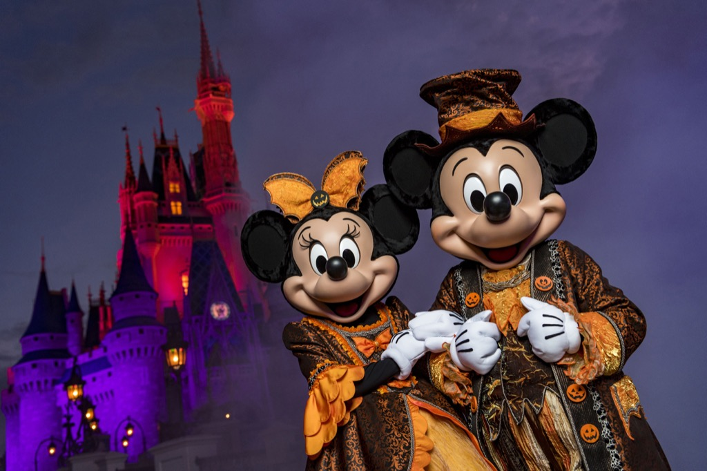 Mickey Mouse and Minnie Mouse dressed for Halloween