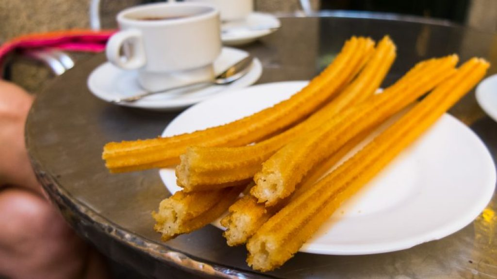 Churros with a cup of coffee in Madrid