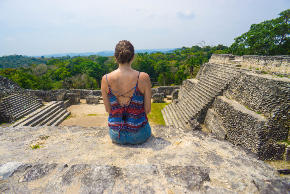 Allison sitting atop a pyramid in the Caracol Complex of ruins