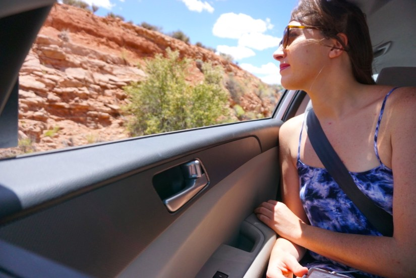 Allison looking out of a car window in Moab
