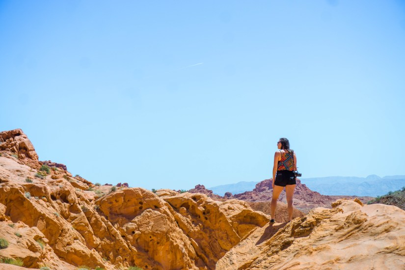 Allison standing on a rock near the Visitor Center of Valley of Fire