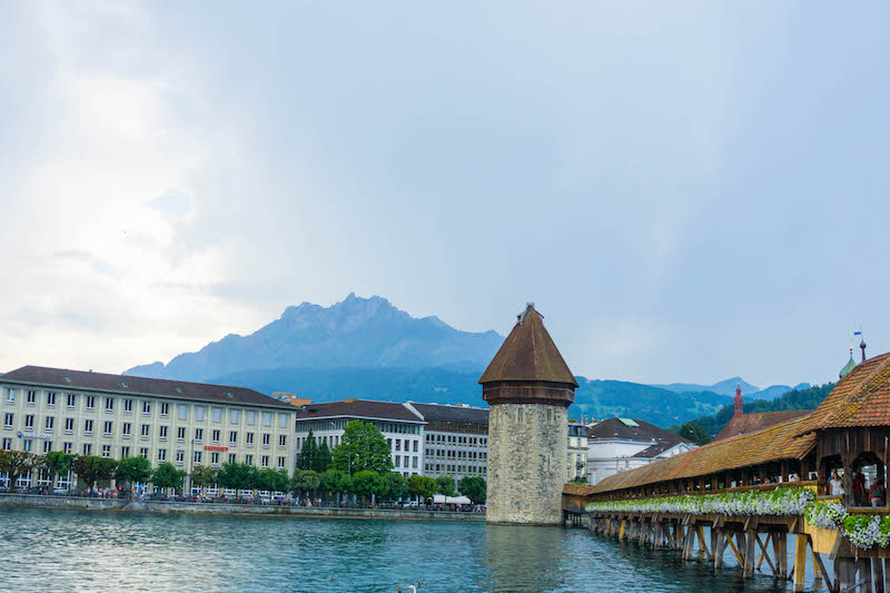 The Chapel Bridge (Kapelbrucke) of Lucerne, Switzerland on a partly cloudy day in summer.