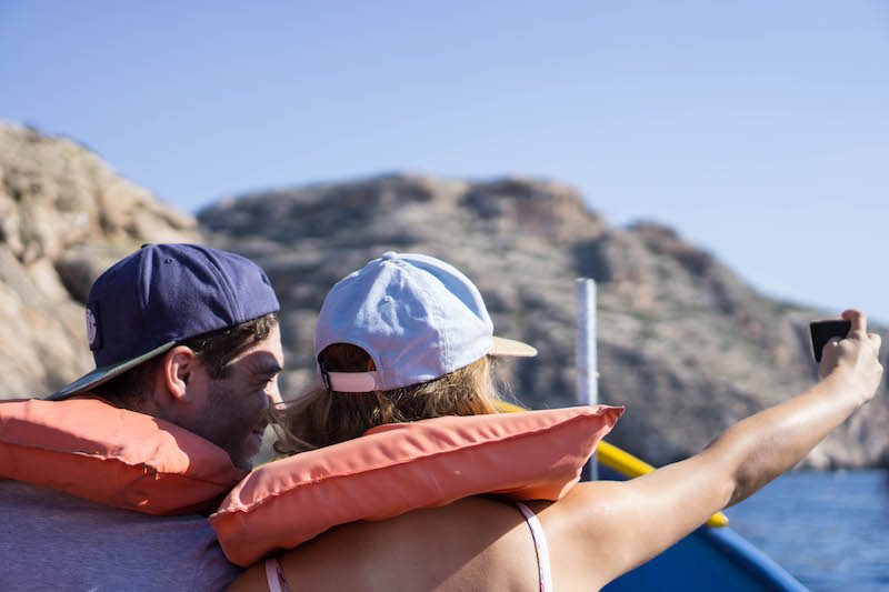 couple taking a selfie at the blue grotto
