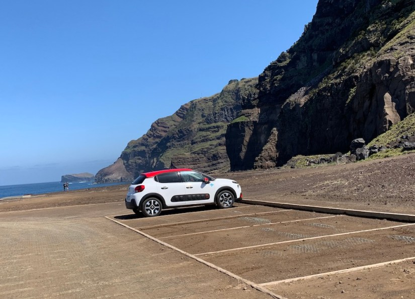 a white car with a red roof in the azores