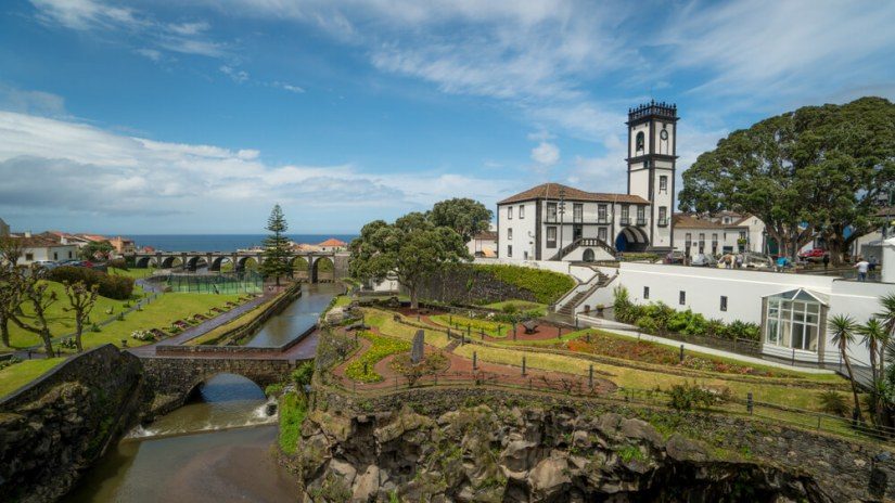 the peaceful town of ribeira grande with its river, church, park, and bridges