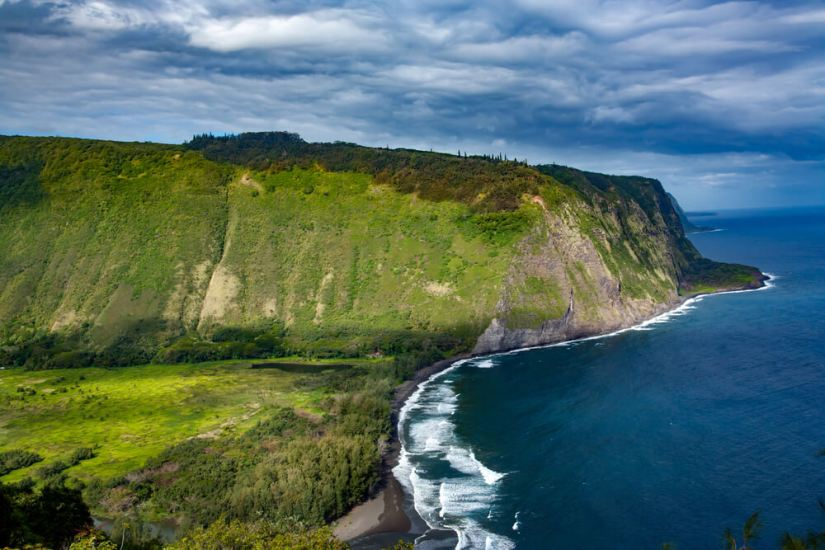 an aerial photo of the beautiful and lushly green waipio valley